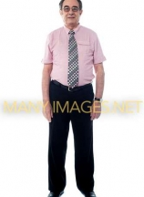 Smiling aged professional businessperson standing