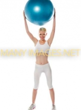 Sporty woman holding ball over her head